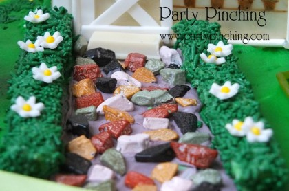 candy rock path, Greenhouse gingerbread house cake, garden party ideas, cute food, fun food for kids, sweet treats, garden cookies, mini vegetables made from candy