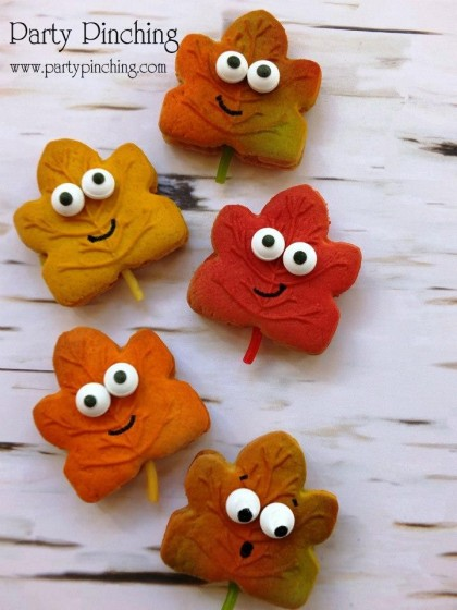 leaf cookies, harvest party ideas, fall cookies, autumn cookies, cute leaf cookies with candy eyes, canada cookies, maple leaf cookies, cute food, fun harvest party Halloween Thanksgiving ideas for kids