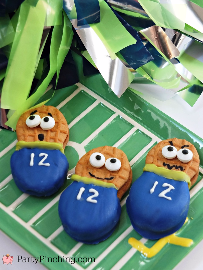 Alternative TextInsert an alternative text here. 12th man cookies, Seahawks cookies, Wilton cookies, sports fan cookies, football cookies, nutter butter fans, super bowl cookies
